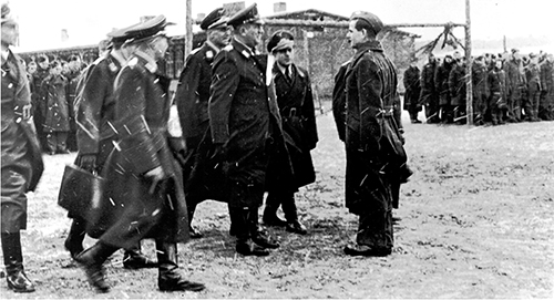 Col. Friedrich von Lindeiner of the German air force (Luftwaffe) walks the grounds at Stalag Luft III during a roll call in winter. Photo courtesy Ted Barris