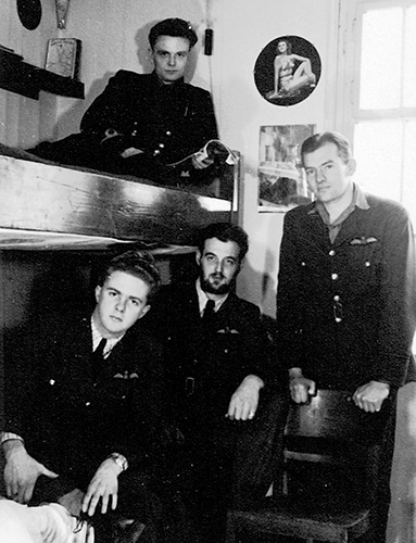 """Downed pilot Wally Floody, the """"Tunnel King"""" who later settled in the Beach, sits with fellow prisoners-of-war in the Stalag Luft I prison camp. Before he was transferred to Stalag Luft III, site of the Great Escape, Floody lead 47 tunnel escape attempts at Luft I. PHOTO: Courtesy Ted Barris"""