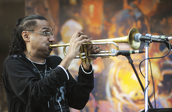 Brownman solos over the backing of his Electryc Trio during the Beaches International Jazz Festival's streetfest portion. Tens of thousands of music lovers flocked to the Beach over the course of 10 days of music, food and fun for the 26th annual festival. PHOTO: Jon Muldoon