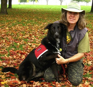 Michelle Threndyle takes a pause with Lucy, her 11 month-old hearing guide dog. Threndyle is selling seasonal cards to help pay for Lucy's training.  PHOTO: Andrew Hudson