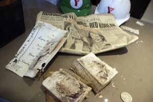 YMCA archivist Ian Fleming with elements discovered inside a time capsule buried in 1952.