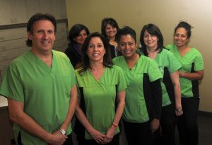 The Quarry Dental Group team includes, front row from left, partners in business and marriage Dr. Allan Katchky and Dr. Cindy Greenspoon, dental assistant Sharm, dental assistant Grace, dental hygenist Jerusha, and, back row from left, receptionists Salima and Lena.